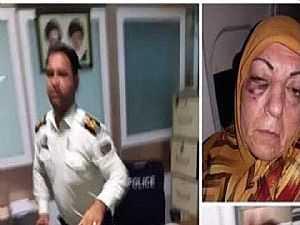ضابط إيراني يضرب سيدة عراقية